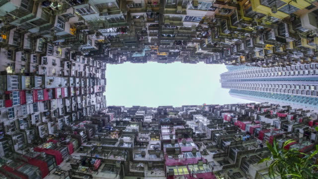 time-lapse day and night buildings, quarry bay, hong kong - poverty stock videos & royalty-free footage