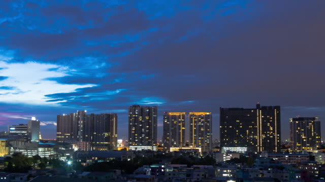4K Time-lapse Day to night: building and skyscraper in Bangkok city.
