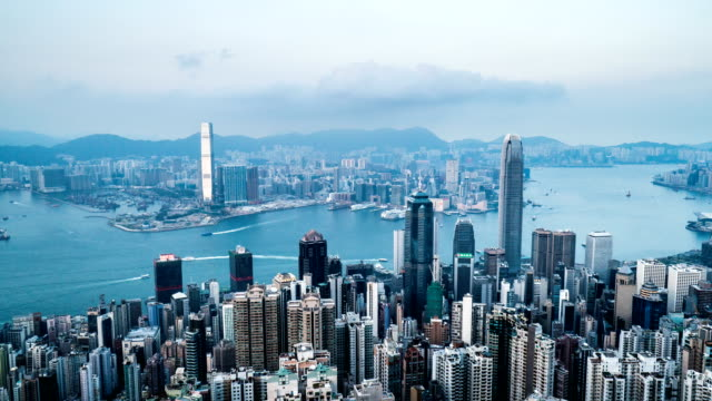4k timelapse - day to night hong kong city pov from victoria peak - wanchai stock videos and b-roll footage