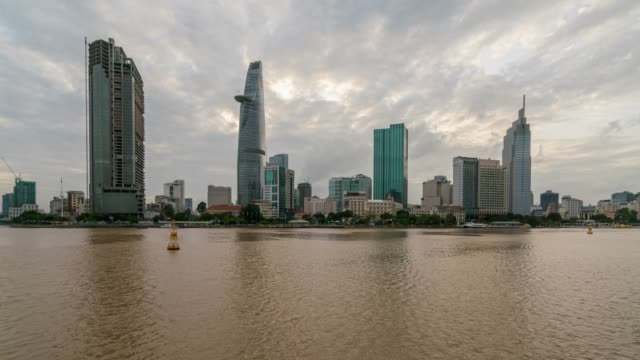 Timelapse day to night of Cityscape of Ho Chi Minh City skyline and skyscrapers in center of heart business at Ho Chi Minh City downtown, Vietnam