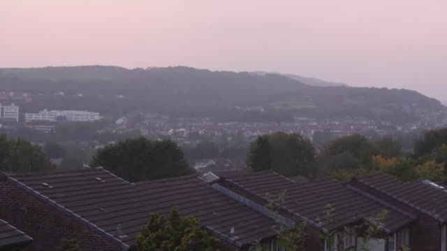 """timelapse day to night of houses in pontypridd as those living in rhondda cynon taff in south wales are put into a local lockdown due to rise in... - """"bbc news"""" stock videos & royalty-free footage"""