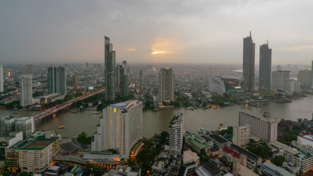 timelapse day to night of sunset scence of bangkok skyline panorama and skyscraper in bangkok city downtown at chao phraya river bangkok thailand. - bangkok stock videos & royalty-free footage