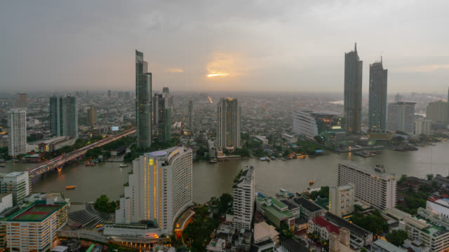 timelapse day to night of sunset scence of bangkok skyline panorama and skyscraper in bangkok city downtown at chao phraya river bangkok thailand. - river chao phraya stock videos & royalty-free footage