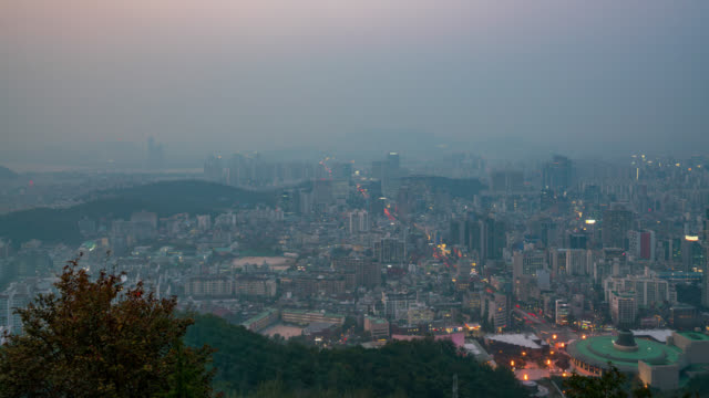 timelapse day to night scene of seoul downtown city skyline, aerial view of n seoul tower in seoul city, south korea - pointing stock videos & royalty-free footage