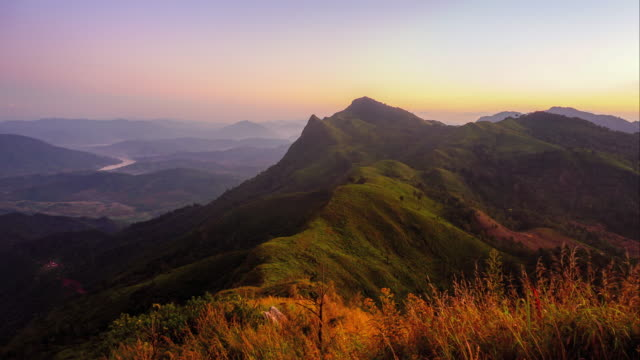 4k time-lapse day to night sunlight with mountain ridge, twilight time , northern of thailand - day to night stock videos & royalty-free footage