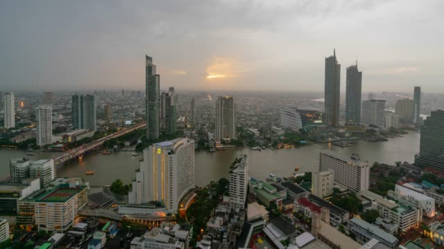 timelapse day to night sunset scence of bangkok skyline panorama and skyscraper ,aerial view of modern office buildings and condominium in bangkok city downtown at chao phraya river bangkok thailand. - day to sunset stock videos & royalty-free footage
