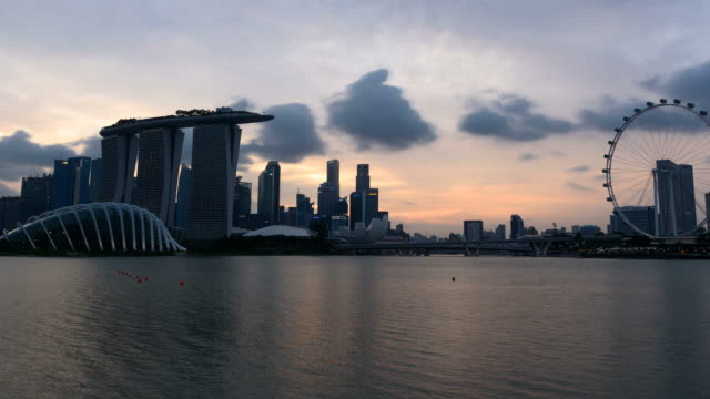 4k time-lapse: day to night time lapse ,skyline of marina bay, singapore. - marina bay sands stock videos and b-roll footage