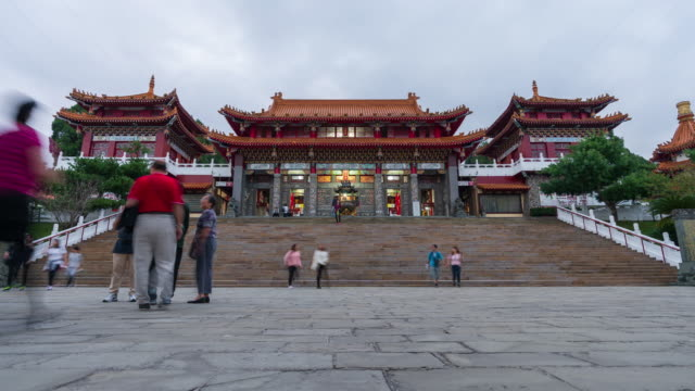 4k time-lapse: day to night time-lapse people crowd at wen wu temple, sun moon lake, taiwan - temple building stock videos & royalty-free footage