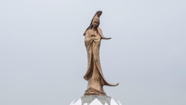 time-lapse daylight statue of kun iam macau - guanyin bodhisattva stock videos & royalty-free footage