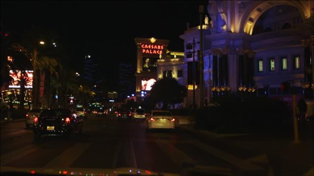 timelapse driving down the las vegas strip at night - venetian hotel las vegas stock videos & royalty-free footage