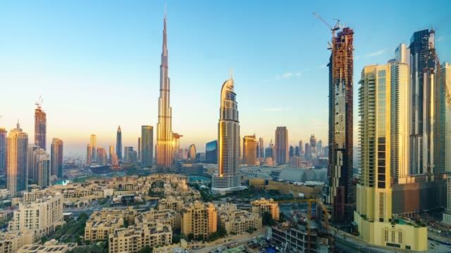 timelapse dubai skyline at sunset / dubai, uae - burj khalifa stock videos & royalty-free footage