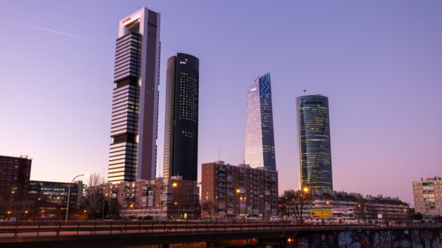 Timelapse during sunset of the iconic Four Towers (Cuatro Torres) in Madrid