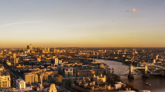 Time-lapse dusk to night of aerial view over London, UK