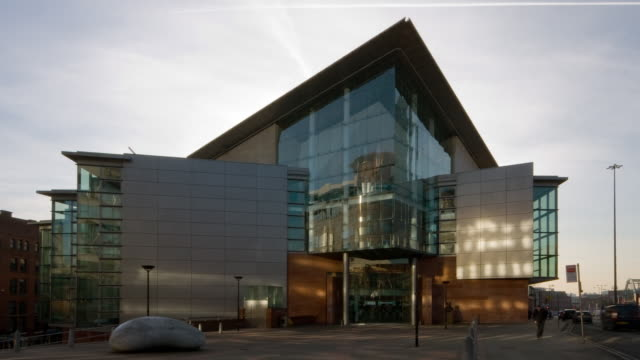 time-lapse early evening sun and shadows falling over the bridgewater hall with slight pull back - bridgewater hall stock videos & royalty-free footage
