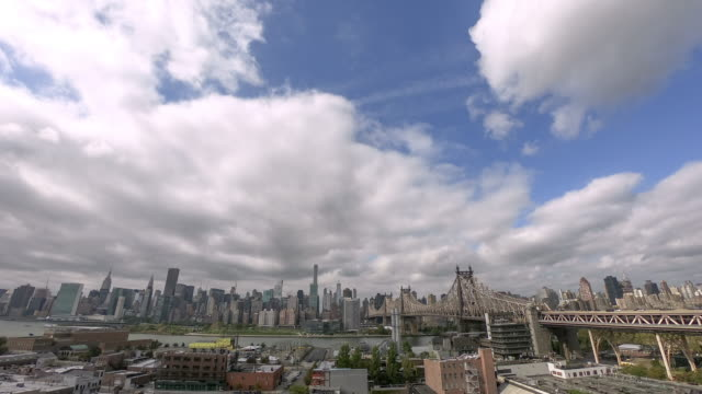 timelapse east manhattan view with queensboto bridge - queensboro bridge stock videos & royalty-free footage