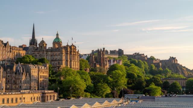 time-lapse: edinburgh cityscape scotland uk sunset - midday stock videos & royalty-free footage