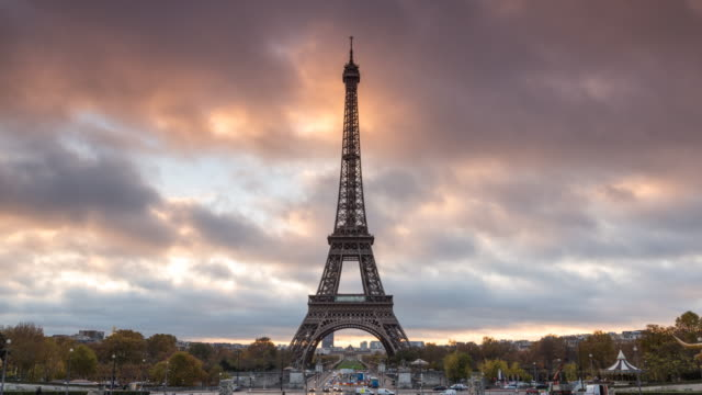 Timelapse: Eiffel tower at sunrise with fast moving clouds, Paris, France