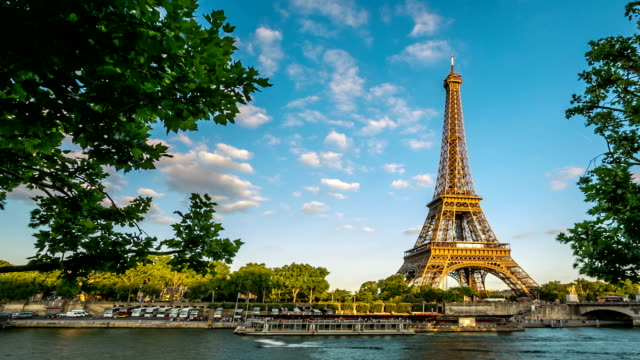 hd time-lapse : eiffel tower paris river seine - eiffel tower stock videos & royalty-free footage