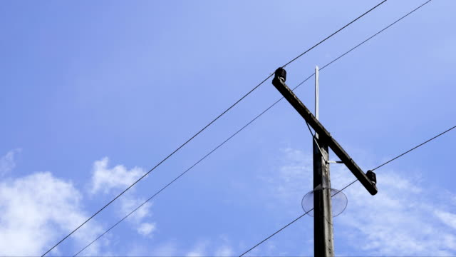timelapse electric pole with blue sky