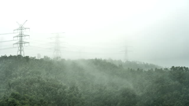 4K Timelapse - Electricity Pylon on the Mountain in Storm Weather