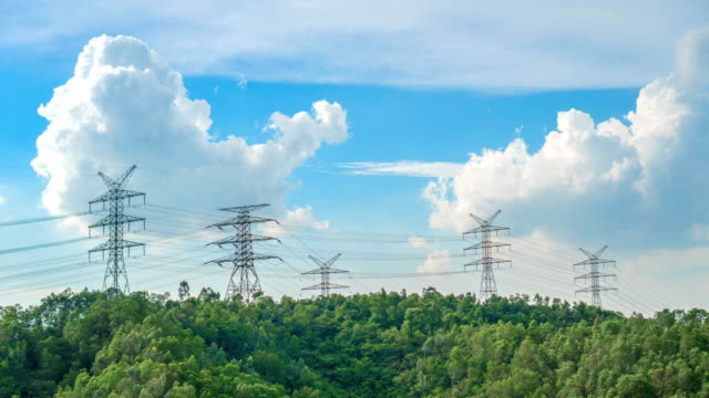 4k timelapse - electricity pylon on the mountain - power in nature stock videos & royalty-free footage