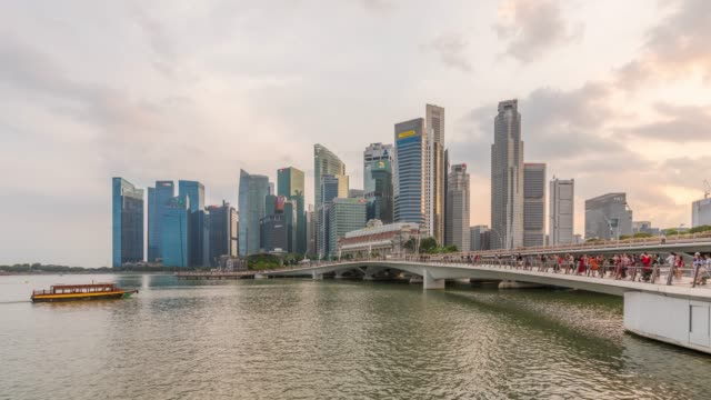 timelapse: esplanade bridge and downtown skyscrapers at marina bay of singapore - marina bay singapore stock videos and b-roll footage