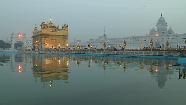 timelapse evening to night golden temple amritsar punjab - punjab india stock videos and b-roll footage