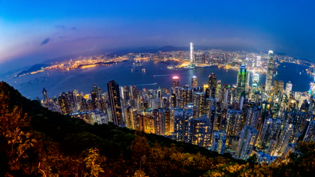 4k timelapse evening to night of hong kong city taken from the peak - victoria peak stock videos & royalty-free footage