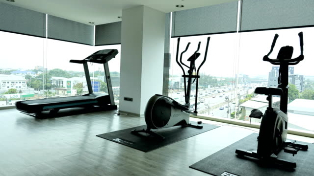 time-lapse: exercise room at aerial view - exercise equipment stock videos & royalty-free footage