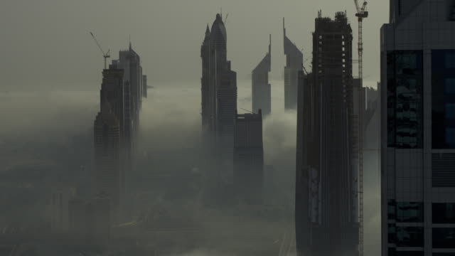 Timelapse fog drifts between skyscrapers and over Sheikh Zayed road, Dubai