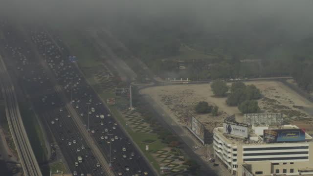 timelapse fog drifts over sheikh zayed road and burj al arab, dubai - film tilt stock videos and b-roll footage