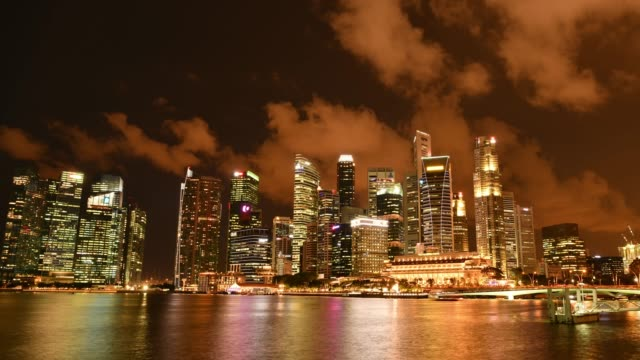 time-lapse footage of financial district in singapore during twilight - marina bay singapore stock videos and b-roll footage
