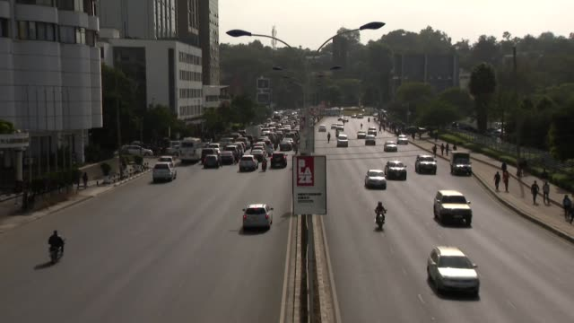 timelapse footage of traffic on busy road with pedestrians crossing the road in nairobi, kenya - traffic time lapse stock videos & royalty-free footage
