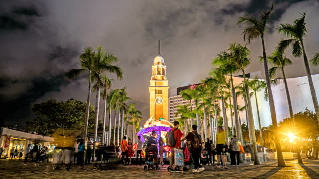 4k timelapse - former kowloon-canton railway clock tower at victoria harbor - clock tower stock videos & royalty-free footage