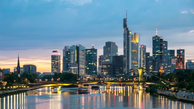 4k time-lapse: frankfurt cityscape along the main river at dusk - frankfurt main stock videos and b-roll footage
