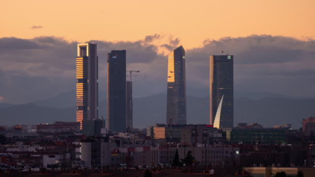 timelapse from distance of the cuatro torres at sunset - madrid stock videos & royalty-free footage