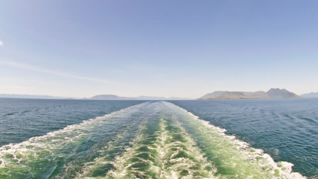 time-lapse from the back of a cruise ship entering a channel in alaska. - wake water stock videos and b-roll footage