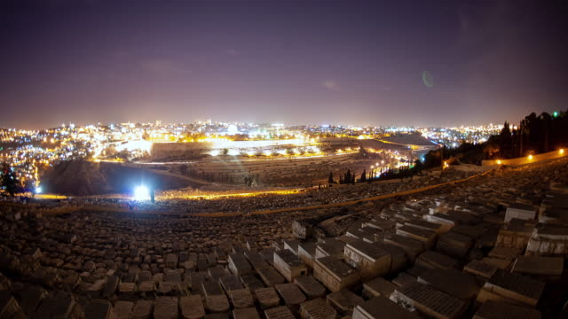 time-lapse from the mount of olives overlooking the cemetery at night - jerusalem stock-videos und b-roll-filmmaterial