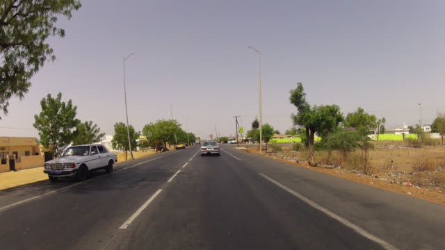 Timelapse POV from vehicle driving along road, Senegal