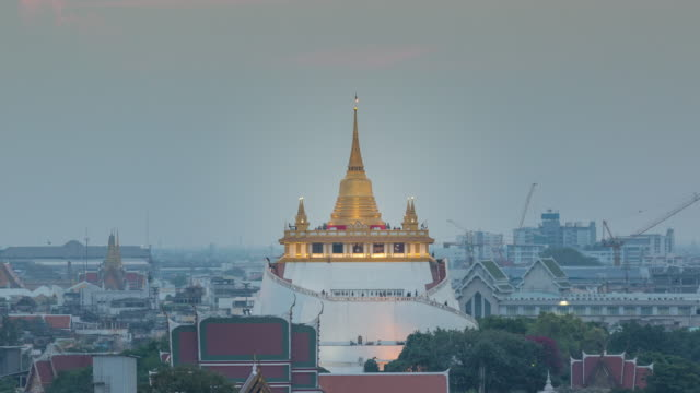 4k time-lapse : golden mountain or wat sraket from day to dusk. - day to dusk stock videos & royalty-free footage