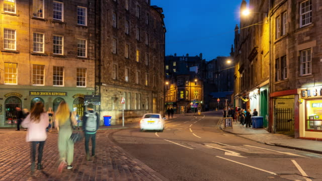 time-lapse: grass market edinburgh old town in scotland uk at night - town stock videos & royalty-free footage