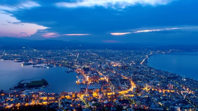 4k time-lapse hakodate in night and day series with clouds at sunrise - hokkaido stock videos & royalty-free footage