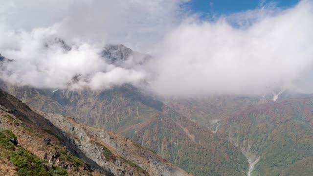 time-lapse: hakuba mountain range with autumn red leave nagano japan - satoyama scenery stock videos & royalty-free footage