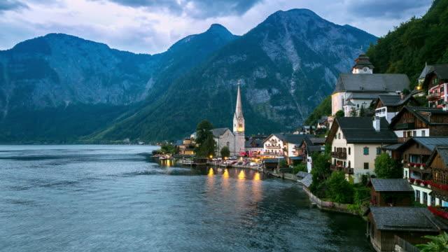 4k time-lapse: hallstatt village cityscape lake austria at dusk - traditionally austrian stock videos & royalty-free footage