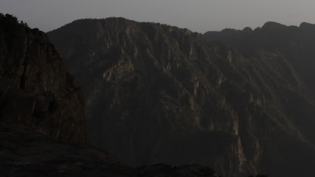 timelapse hamadryas baboons (papio hamadryas) on mountain, saudi arabia - saudi arabia stock videos and b-roll footage