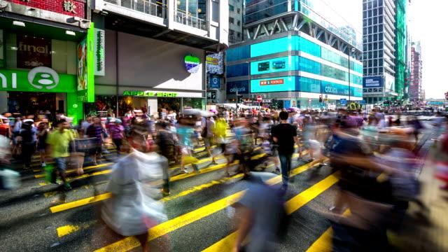 time-lapse hd: pedestrians at causeway bay crossing street hong kong - causeway stock videos & royalty-free footage