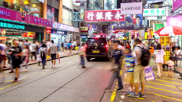 time-lapse hd: pedestrians at mong kok shopping street hong kong - central district hong kong stock videos and b-roll footage