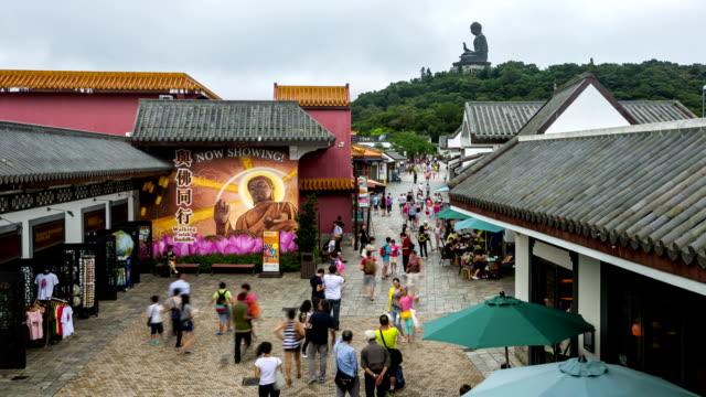 time-lapse hd: pedestrians at ngong ping giant buddha hong kong - lantau stock videos and b-roll footage
