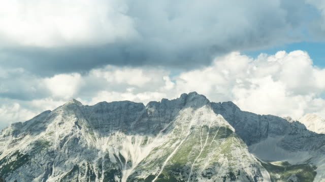 timelapse high angle scenic view of cloudscape on alps of austria in the morning summer season, hafelekarspitze-seegrube at karwendel mountain, innsbruck austria.  one of the travel destinations in austrian culture and the european alps of europe. - austrian culture stock videos & royalty-free footage