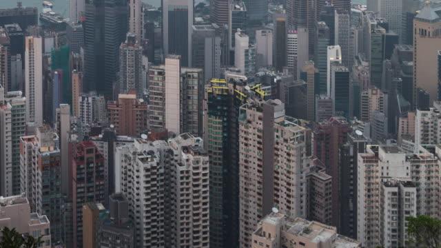 vídeos de stock e filmes b-roll de time-lapse: high definition of traffic time lapse during sunset twilight in hong kong central - filme colagem